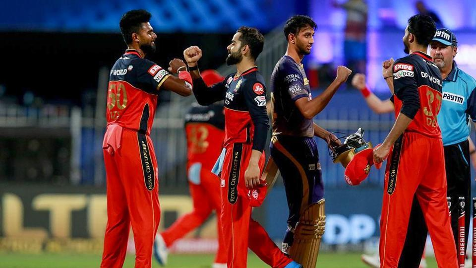 Royal Challengers Bangalore captain Virat Kohli celebrates with his team after wining a match against Kolkata Knight Riders during IPL 2020, at Sharjah Cricket Stadium.