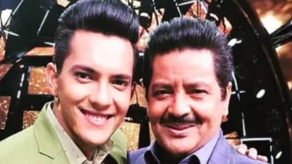 Aditya Narayan poses with dad Udit Narayan.