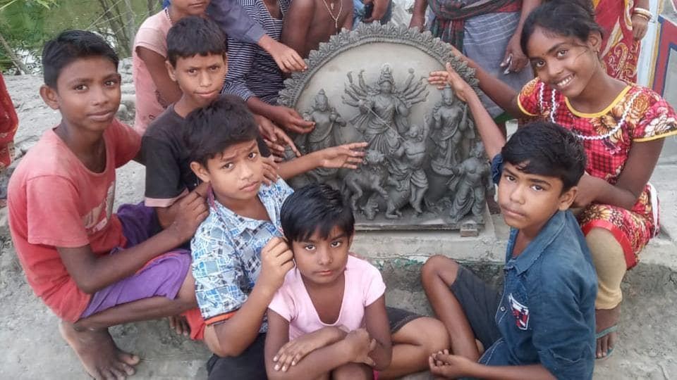 The idol is being made by Mondol and her friends at Bhandarjhali village, while another group of children in Mathurapur village in south Bengal is busy making the decorations with