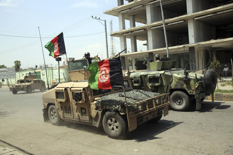 UNofficial says the Taliban had been constantly in touch with Al-Qaeda. In Picture - Afghan security personnel gather near a prison after an attack in the city of Jalalabad, east of Kabul.
