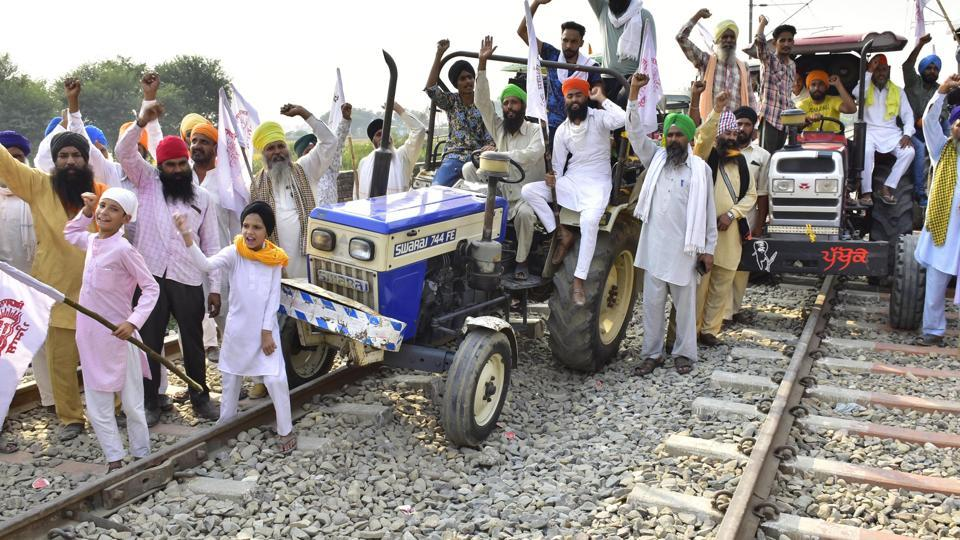 Farmers protesting on tractors along railway line during the ongoing 'Rail Roko' or 'Stop the Trains' protest against the new agriculture laws in Amritsar earlier this week.