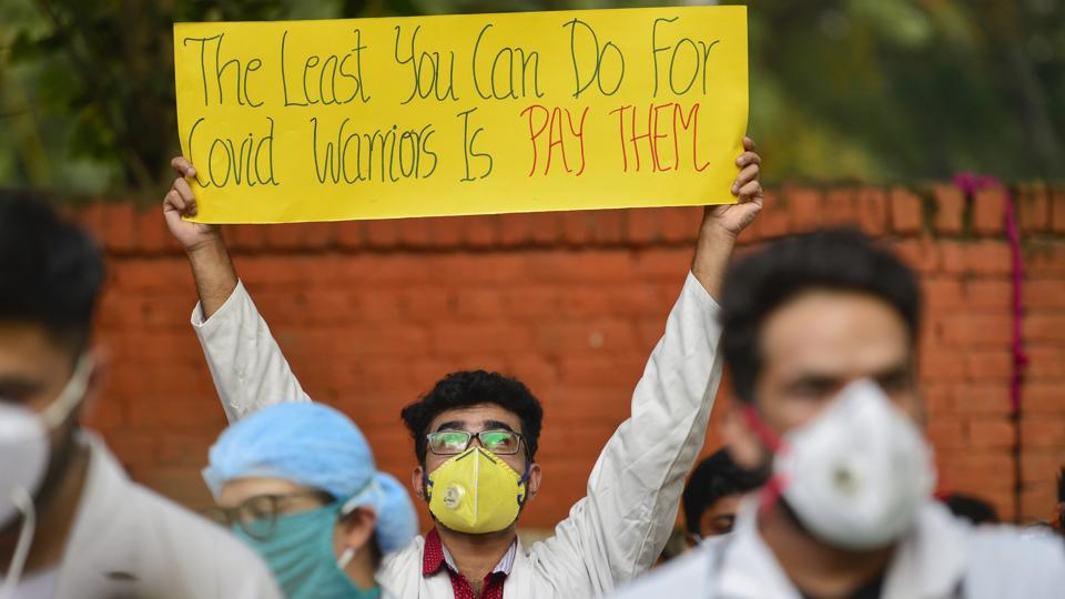 Doctors of Hindu Rao Hospital display placards and shout slogans during a protest against North Delhi Municipal Corporation over non-payment of their pending salaries, at Jantar-Mantar in New Delhi.