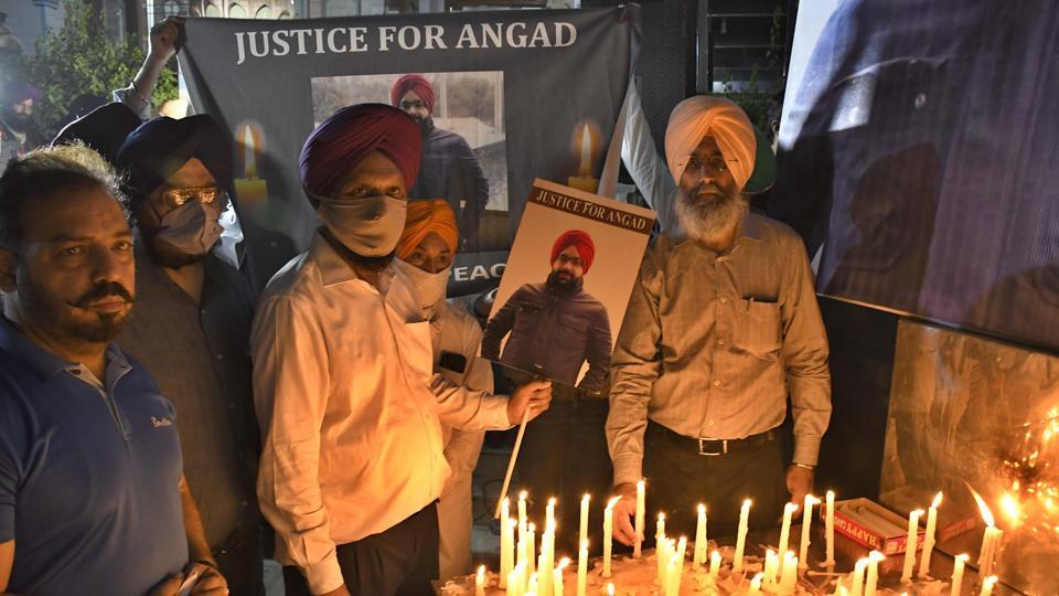 Family members of deceased industrialist Angad Ahuja carrying out a candle march near Baba Deep Singh Gurdwara in Model Town Extension, Ludhiana, on Sunday.