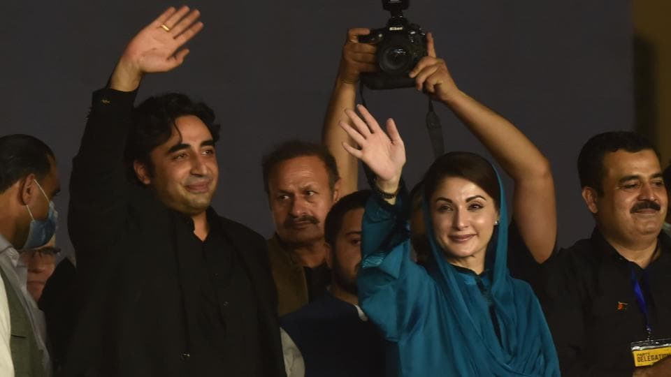 Bilawal Bhutto Zardari (L) and Maryam Nawaz Sharif wave to supporters during the first public rally of the 11-party Pakistan Democratic Movement in the eastern city of Gujranwala on October 16.