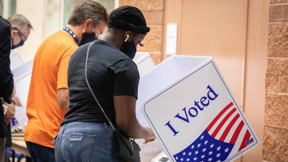 Young US poll workers brace for Election Day as virus fears keep elders home