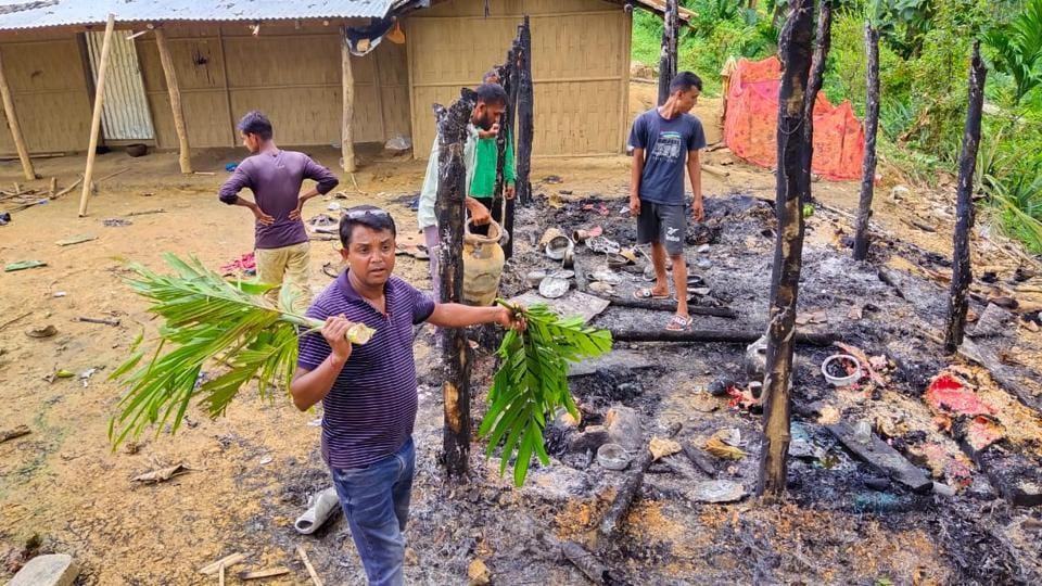 Assam officials inspecting the temporary huts which were torched on the Assam-Mizoram border on Saturday night.