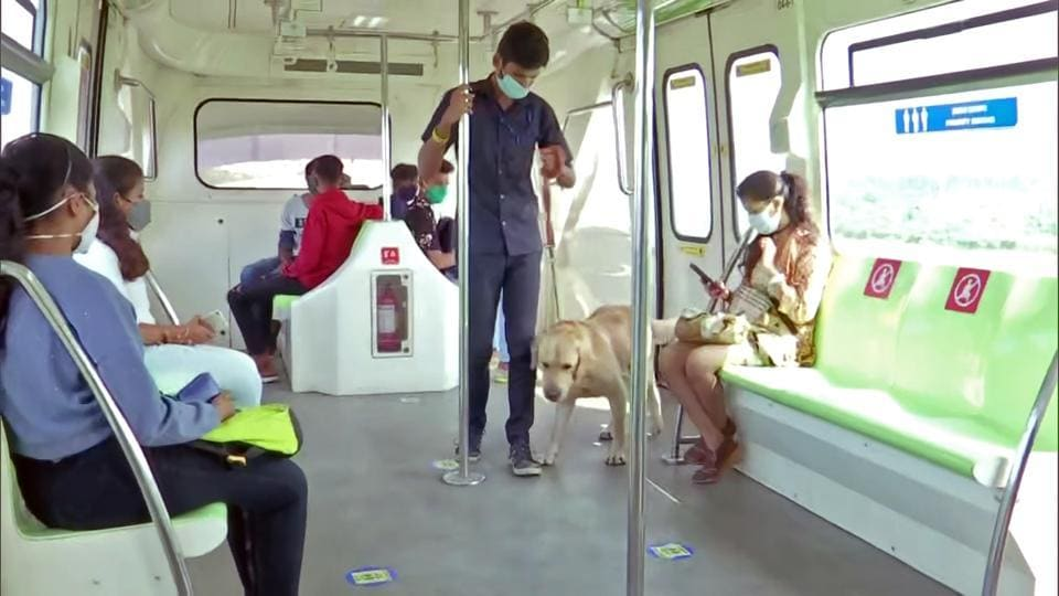 Commuters travel in the Mumbai Monorail as its services resume after months, in Mumbai on Sunday.