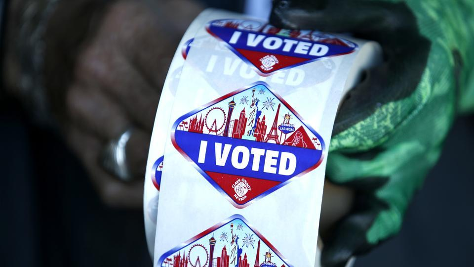 A poll worker displays