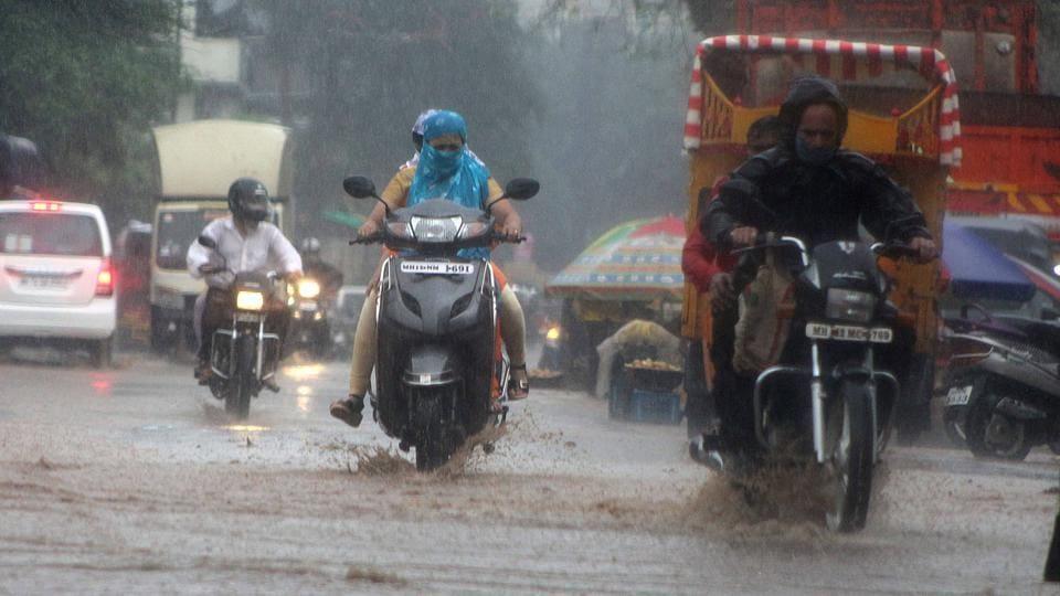 Heavy rain at Jambhulwadi road in Pune on Sunday.