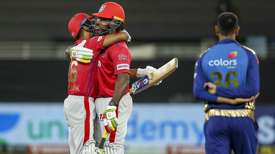 Dubai: Kings XI Punjab players Mayank Agarwal and Chris Gayle celebrate after winning their Indian Premier League (IPL) T20 cricket match against Mumbai Indians (MI), at Dubai International Cricket Stadium in Dubai, Sunday, Oct. 18, 2020.