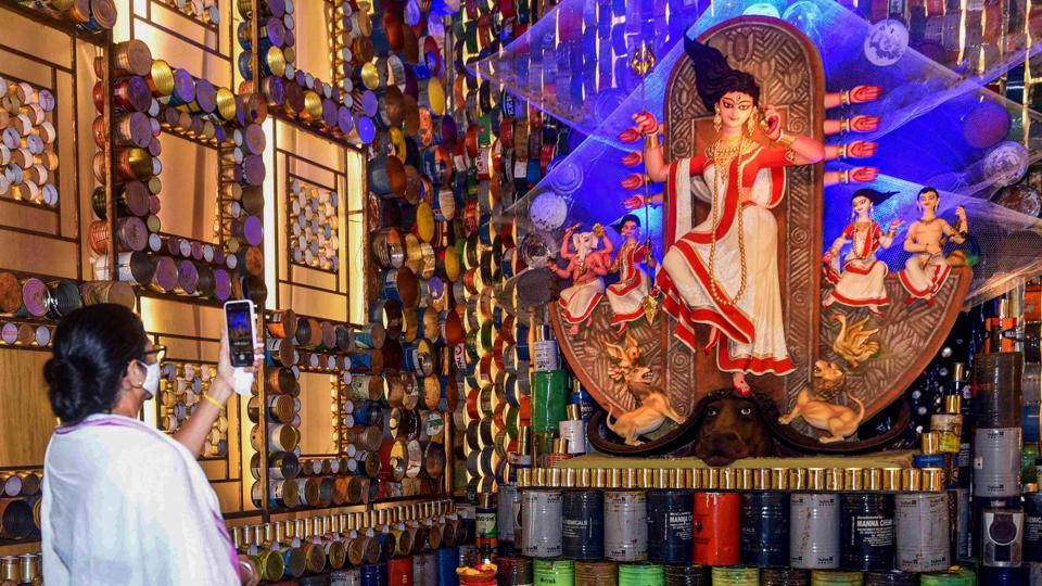 West Bengal Chief Minister Mamata Banerjee clicks picture as she inaugurates a Durga Puja pandal in Kolkata on October 18, 2020.