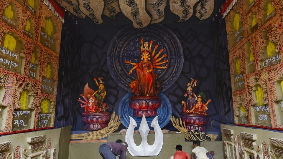 An idol of goddess Durga at a community puja pandal ahead of the Durga Puja festival in Kolkata.