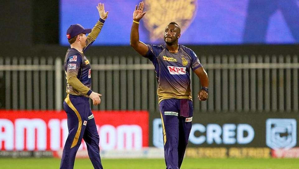 Kolkata Knight Riders player Andre Russell celebrates with Eoin Morgan.