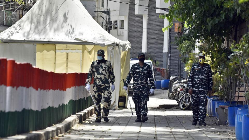 Paramilitary personnel seen at the cordoned off entry route to the Tablighi Jamaat's Alami Markaz Banglewali Masjid building on day twenty of the 21-day nationwide lockdown to curb the spread of coronavirus, in Nizamuddin, New Delhi.