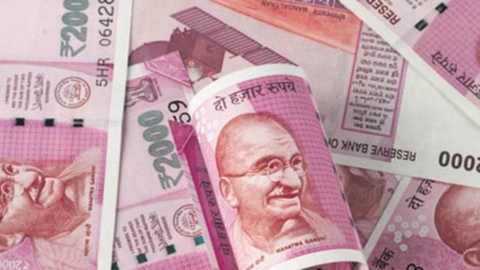 Rupee settles 12 paise lower at 73.49 against US dollar