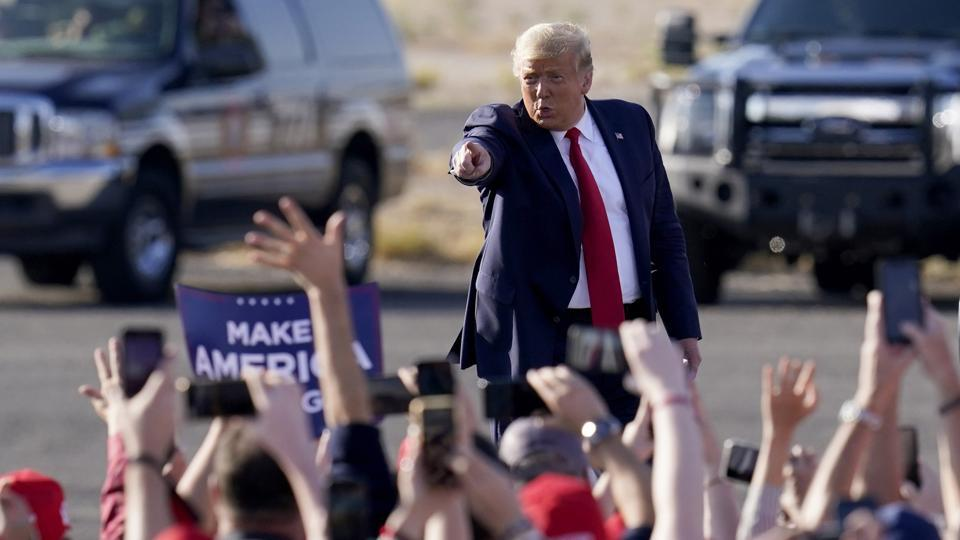 US president Donald Trump waves to a cheering crowd as he arrives for a campaign rally in Tucson, Arizona (AP/PTI Photo)