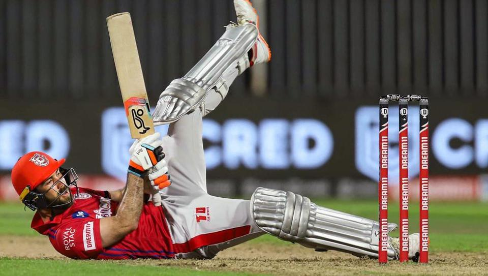 Kings XI Punjab batsman Glenn Maxwell falls on the ground during the Indian Premier League 2020 cricket match against Rajasthan Royals, at Sharjah Cricket Stadium, Sharjah.