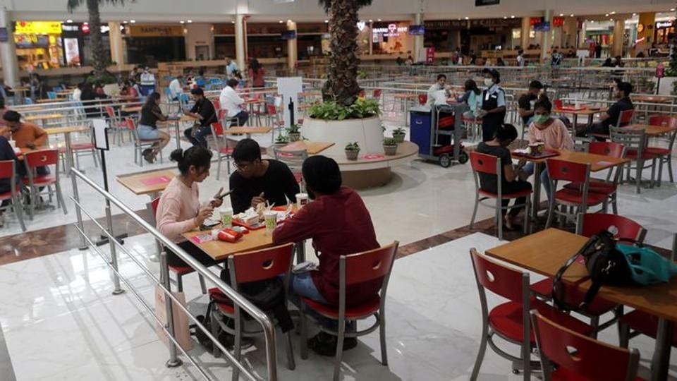 People eat at a food court at a mall in Mumbai after they reopened amidst the spread of the coronavirus disease (Covid-19) in this file photo.
