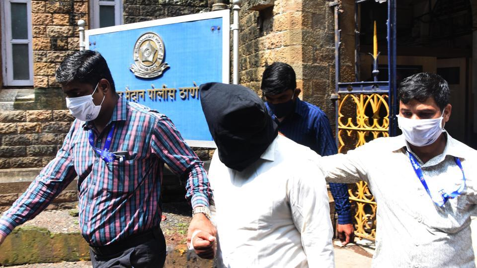 One of the accused in the alleged TRP scam being produced at Esplanade Court in Mumbai, on October 15.