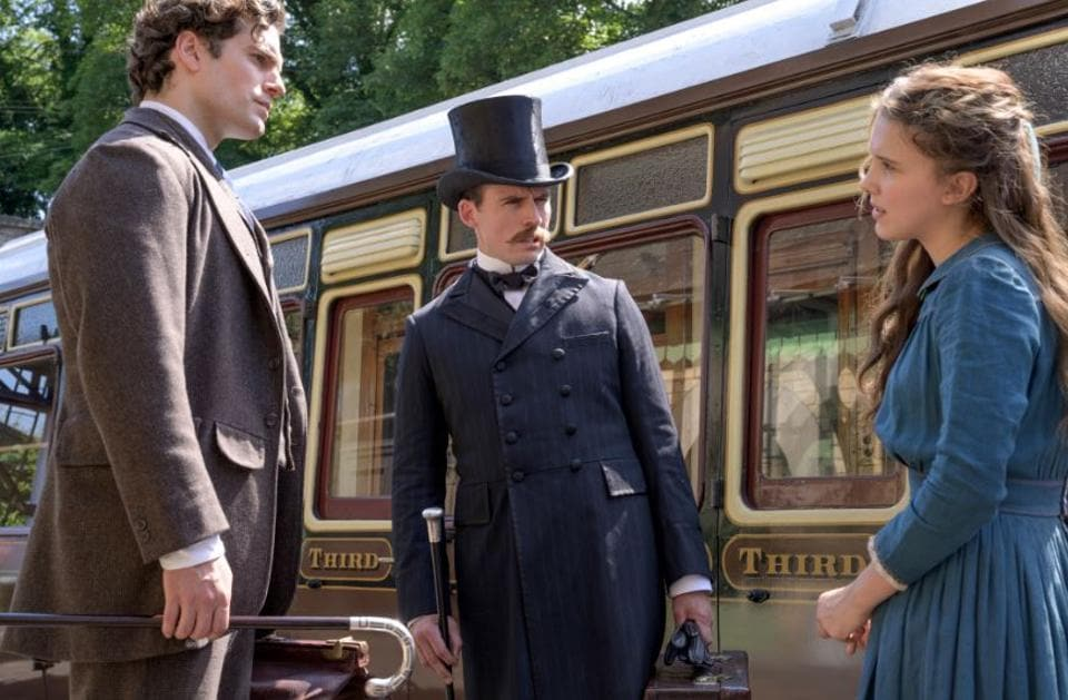 Millie Bobby Brown, Henry Cavill and Sam Claflin in a still from Enola Holmes.