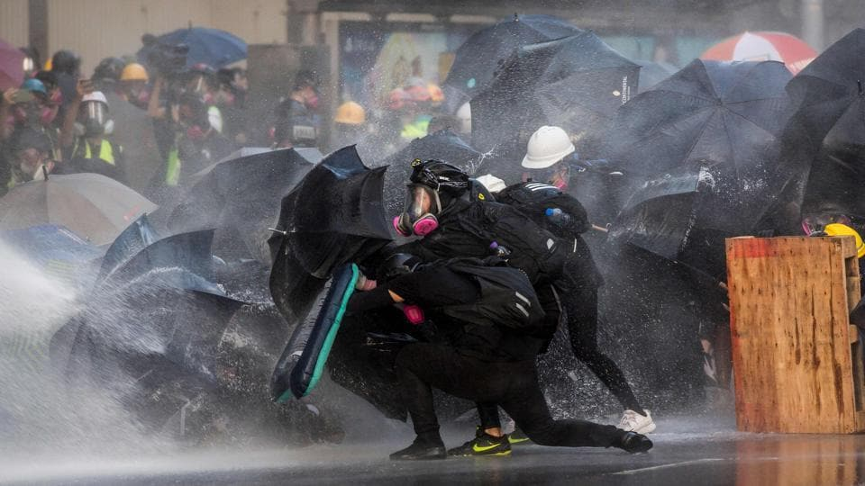 Hong Kong riot police fired tear gas and water cannons on September 15 at hardcore pro-democracy protesters hurling rocks and petrol bombs, in a return to the political chaos plaguing the city