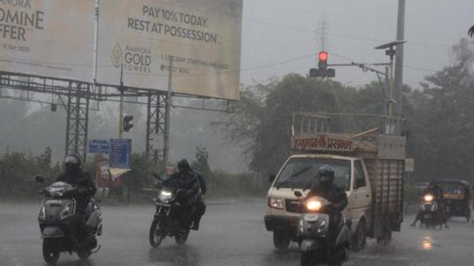 Motorists race through the Mundhwa signal after a spell of rainfall in Pune.