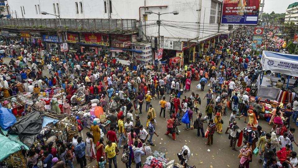 Huge mass of people can be seen shopping at the New Market area ahead of Durga Puja festival in Kolkata.