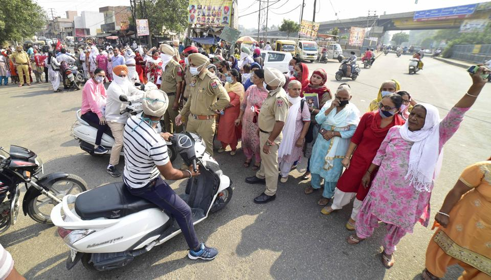Anganwadi workers protesting on Gill Road in Ludhiana on Wednesday.