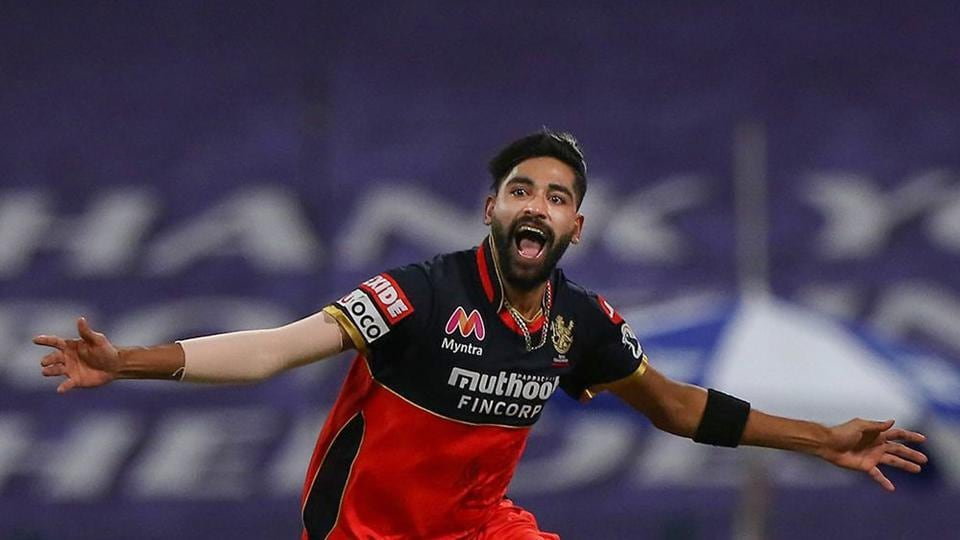Abu Dhabi: Royal Challengers Bangalore player Mohammed Siraj celebrate the wicket of Kolkata Knight Riders batsman Nitish Rana during Indian Premier League (IPL) cricket match, at Sheikh Zayed Stadium, in Abu Dhabi, Wednesday, Oct. 21, 2020. (PTI Photo/Sportzpics)(PTI21-10-2020_000210B)