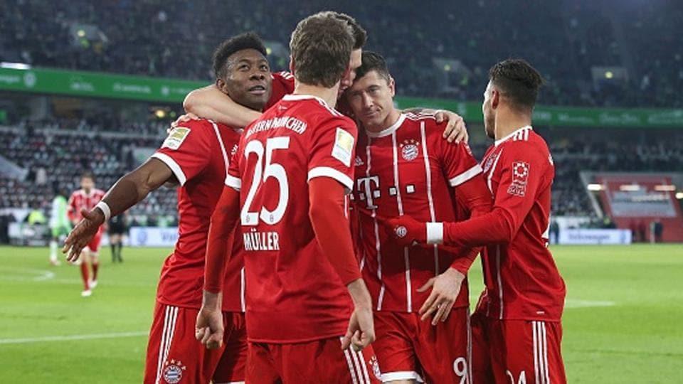 Bayern Munich players celebrate a goal.