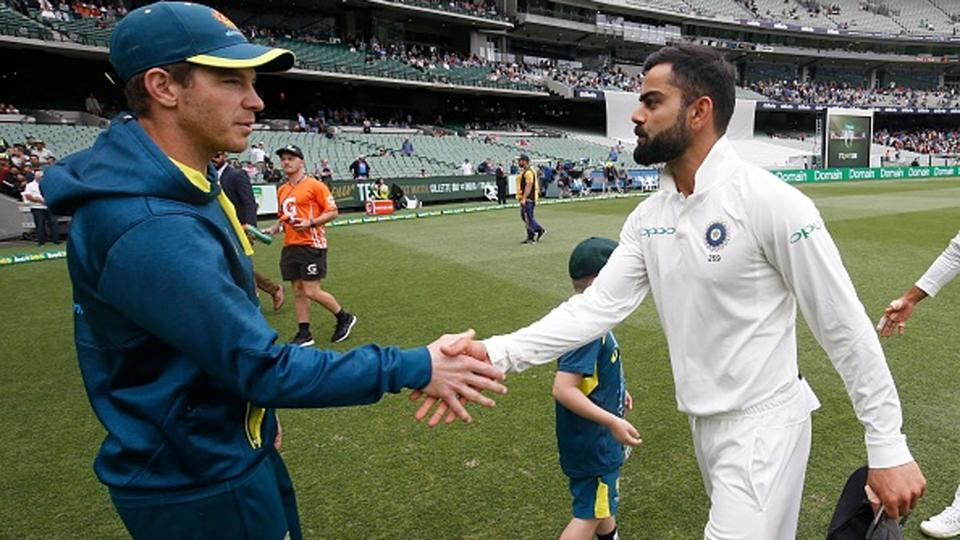 Australia captain Tim Paine (L) shakes hands with India skipper Virat Kohli
