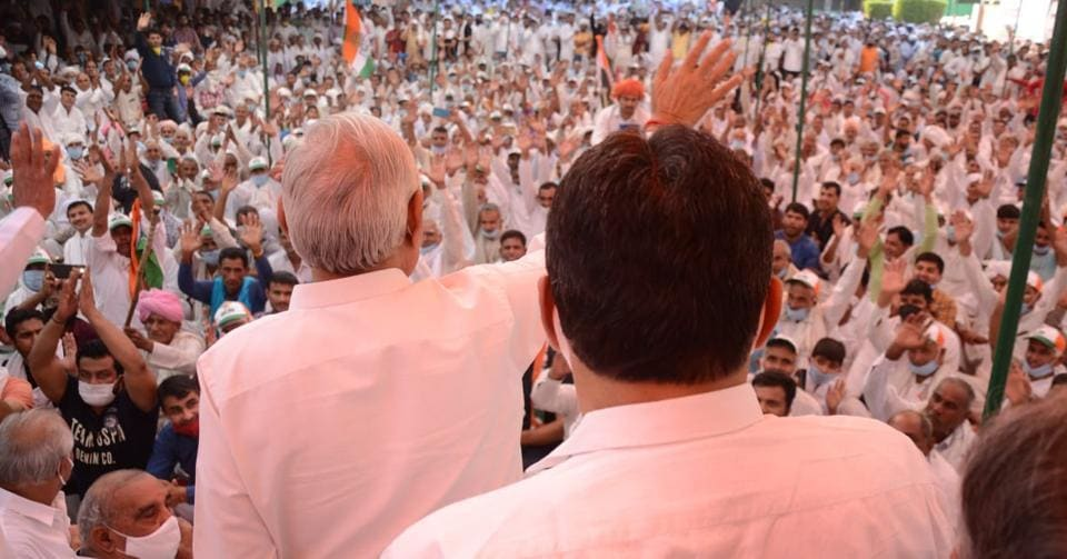 Leader of opposition Bhupinder Singh Hooda and Deepender Hooda addressing a meeting in Sonepat's Gohana. In clear violation of EC's 200-people limit on gatherings, a huge crowd had gathered for the meeting, many without masks.