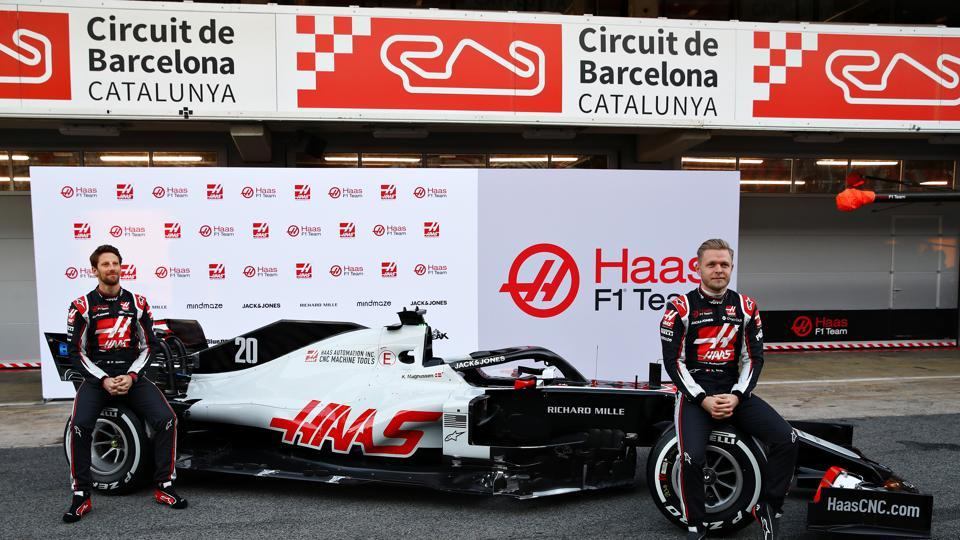 Romain Grosjean of France and Haas F1 and Kevin Magnussen of Denmark and Haas F1 are pictured at the roll out of the Haas F1 Team VF-20 Ferrari during day one of Formula 1 Winter Testing at Circuit de Barcelona-Catalunya on February 19, 2020 in Barcelona, Spain.