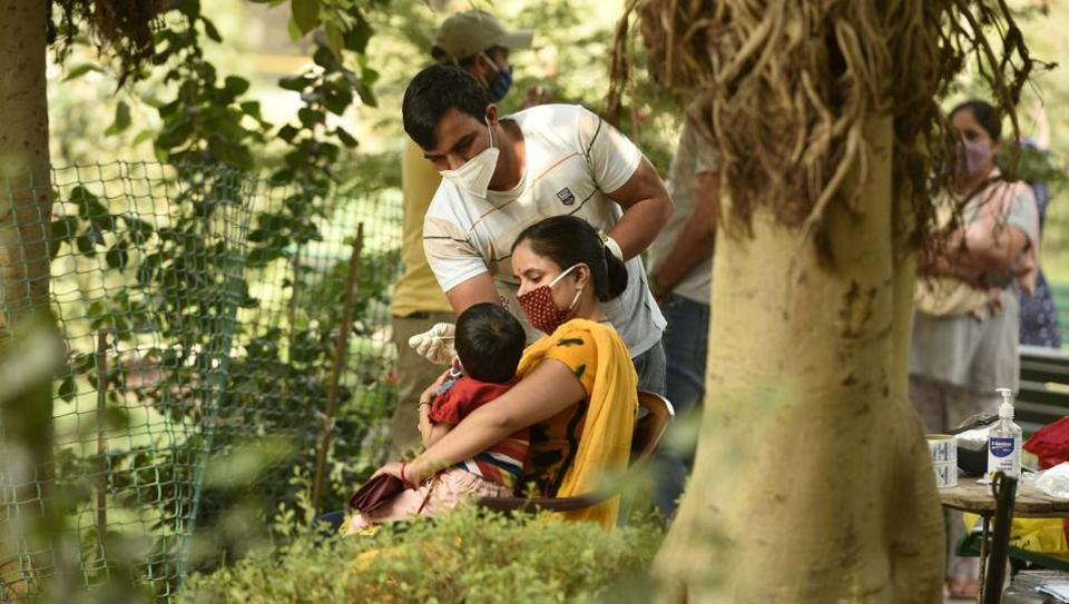 A health worker collects a swab sample from a child for Reverse Transcription-Polymerase Chain Reaction (RT-PCR) based coronavirus testing in a containment zone at Chhatrapati Shivaji Park in Shivaji Nagar, Gurugram, India, on Thursday, October 22, 2020. (Representational)