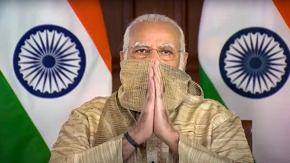 Prime Minister Narendra Modi gestures as he addresses the people of West Bengal on the occasion of Durga Puja, via video conferencing, in New Delhi on Thursday.
