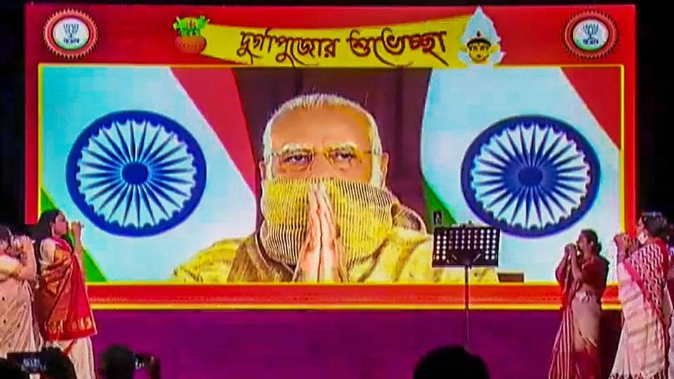 Prime Minister Narendra Modi gestures as he inaugurates a Durga Puja pandal, via video conferencing, in New Delhi, Thursday, October 22, 2020.
