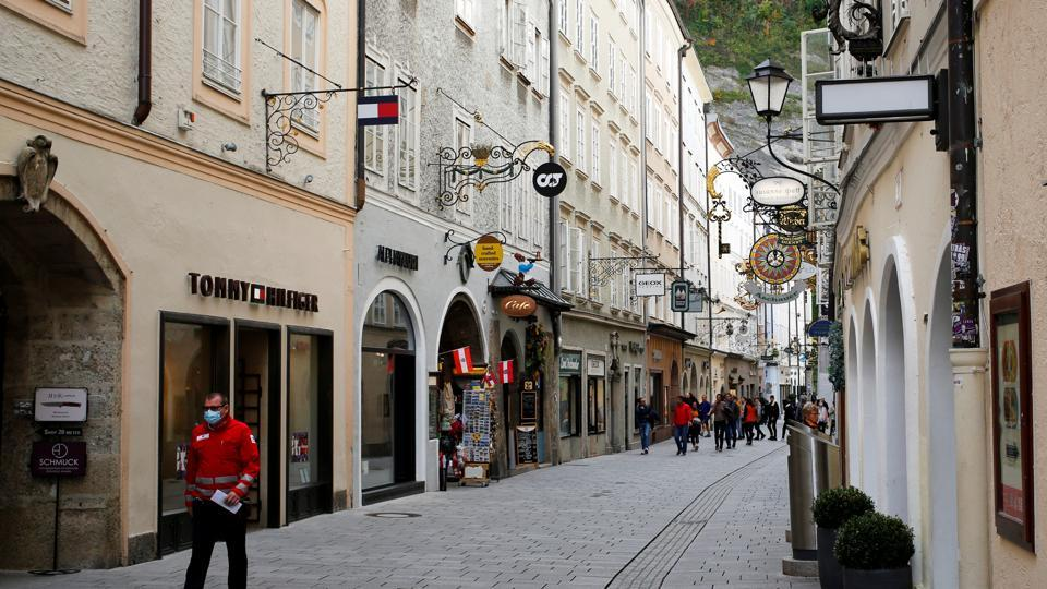 Man, wearing a protective mask, walks down Getreidegasse, as the coronavirus disease (Covid-19) outbreak continues, in Salzburg, Austria October 21, 2020.
