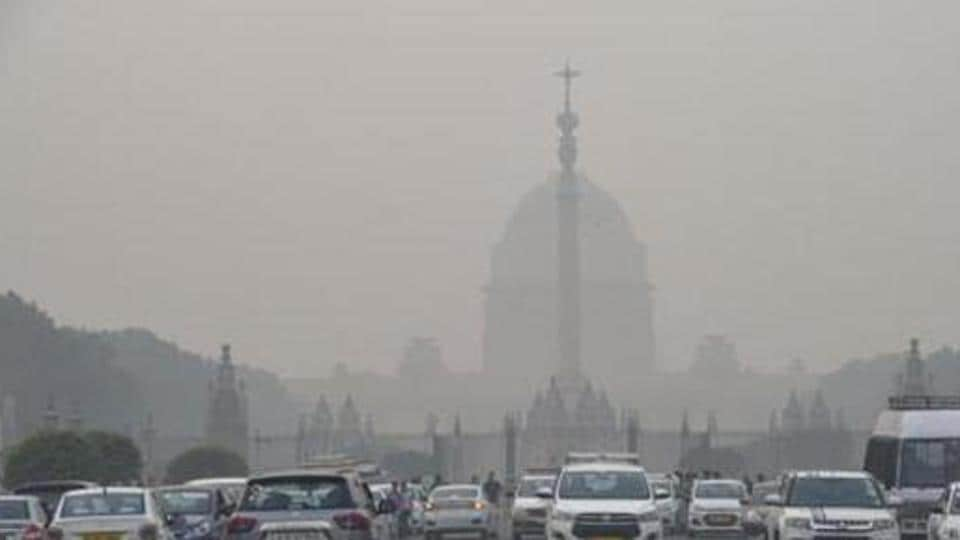 Vehicles ply amid a dense layer of smog at Rajpath, in New Delhi.