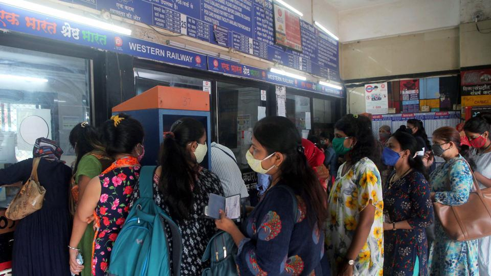 Women passengers stand in the queue at the ticket window at Borivali Railway Station, in Mumbai on Wednesday.