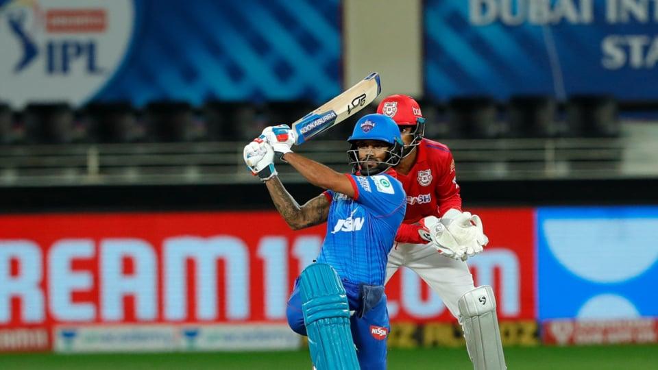 Shikhar Dhawan hits a shot.