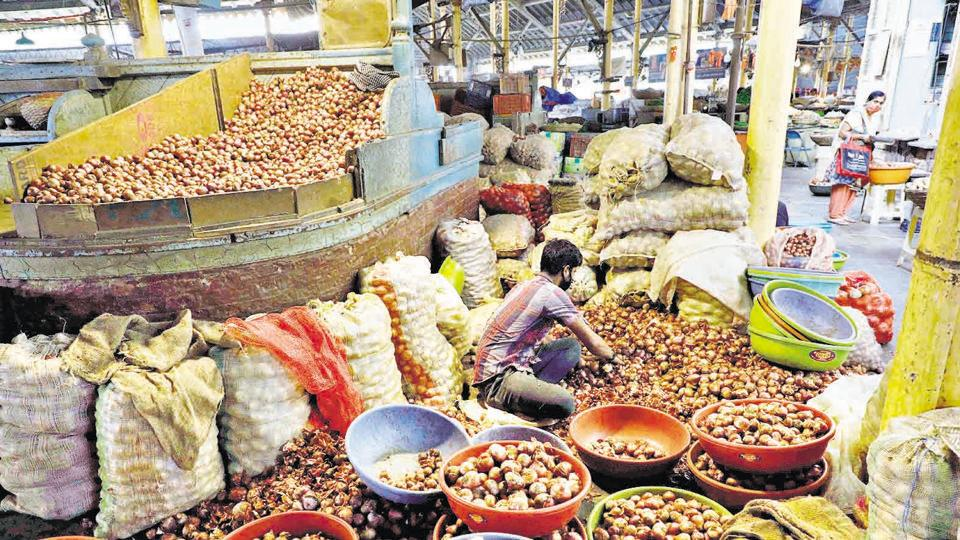 A vendor sorts onion at Mandai in Pune on October 22.