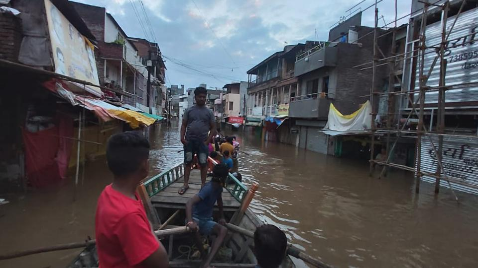 People are seen rowing in flooded areas  in Maharashtra's Pandharpur in this file photo. The Maharashtra government on Friday announced a relief package of Rs 10,000 crore for the rain-affected parts of the state.