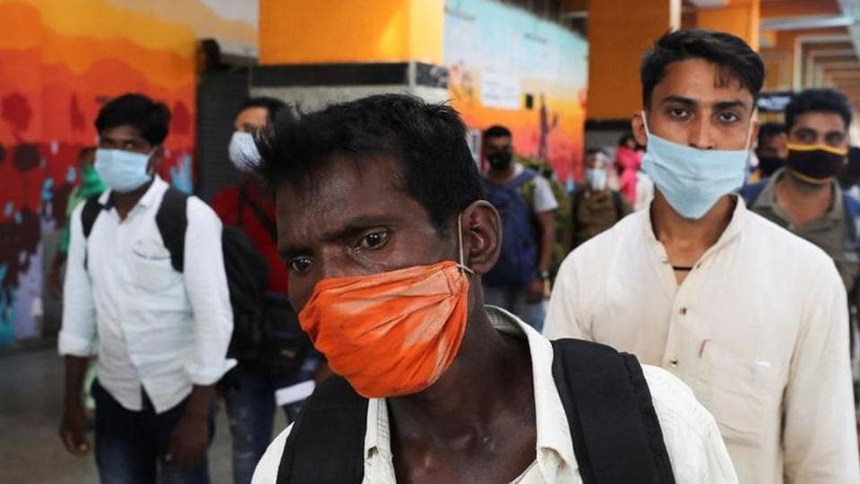 Passengers wearing protective masks stand in a queue to get tested for Covid-19), at a railway station in New Delhi earlier this month.