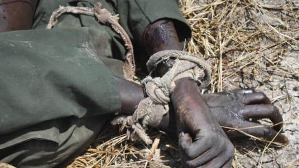 FILE - In this Sunday, Oct. 16, 2016 file photo, the body of a rebel soldier who died in a battle days before has his hands tied, in Malakal, South Sudan. The latest report on human rights abuses in South Sudan's five-year civil war, released by a United Nations commission Friday, Feb. 23, 2018 says it has identified more than 40 senior military officials
