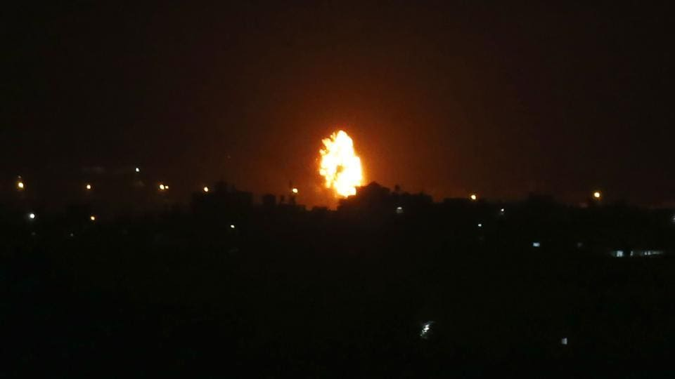 Flames are seen following an Israeli air strike in the town of Khan Yunis, in the southern Gaza Strip, early on October 23, 2020.
