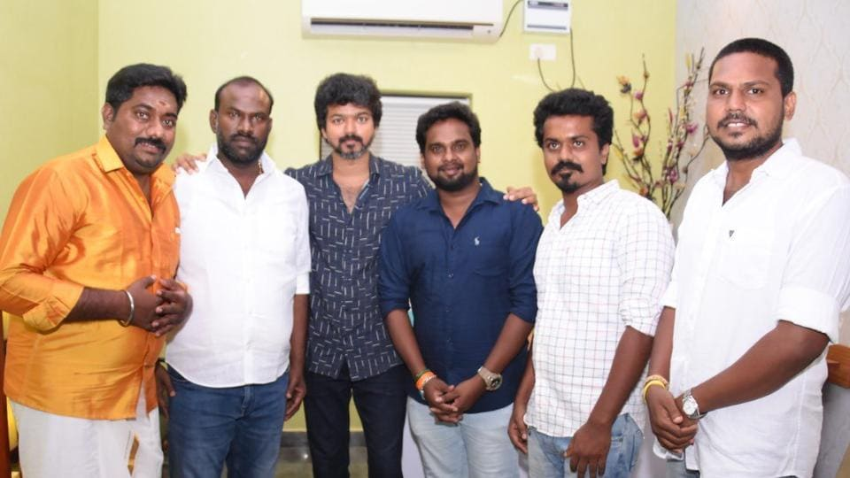 Vijay poses with his fans.