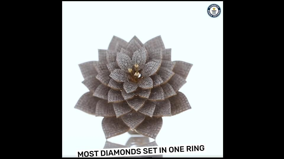 The image shows the ring with 7,801 diamonds.