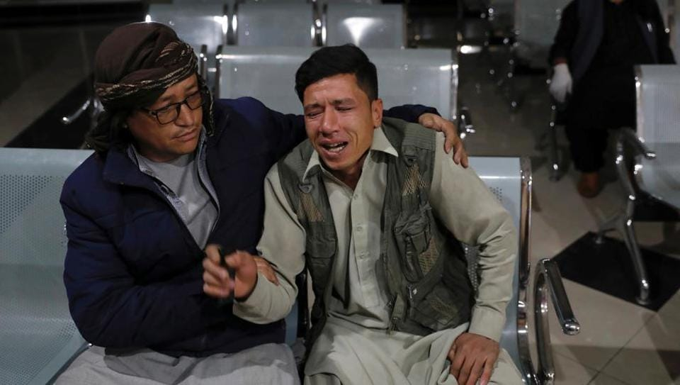 An Afghan man who lost his brother mourns at a hospital after a suicide bombing in Kabul, Afghanistan October 24, 2020.