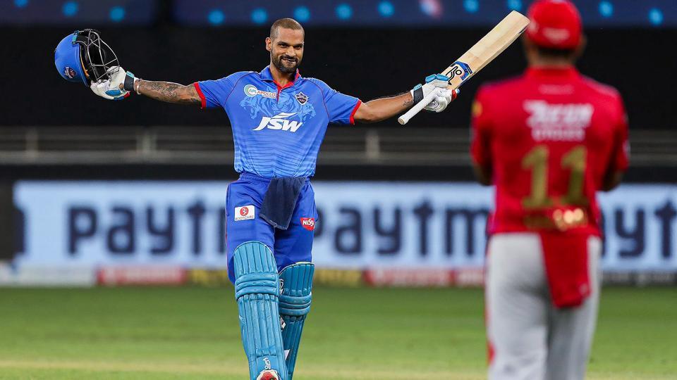Delhi Capitals batsman Shikhar Dhawan celebrates his century during the Indian Premier League (IPL) T20 cricket match against Kings XI Punjab.
