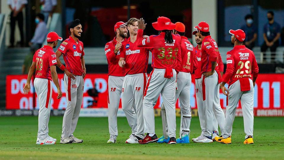 Kings XI Punjab players celebrate the wicket of Delhi Capitals batsman Prithvi Shaw during the Indian Premier League (IPL) T20 cricket match, at Dubai International Cricket Stadium in Dubai.